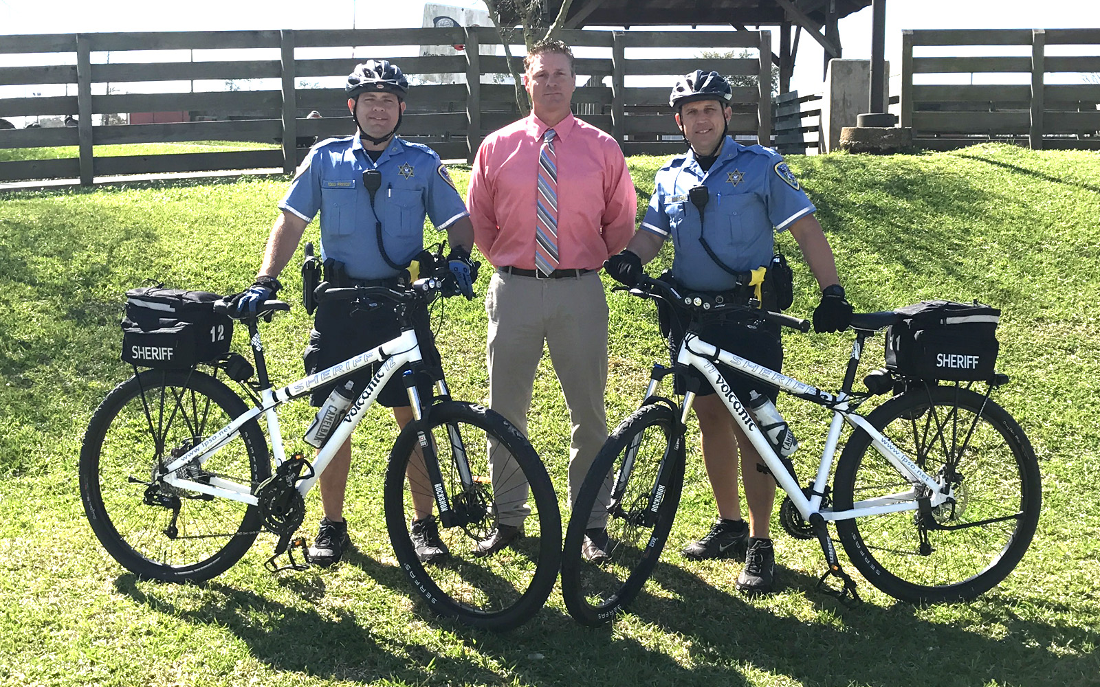 Sergeant Todd Prevost (left) and Deputy Jason Matherne (right) pictured with John Champagne (center) of the Community Crusaders of Lafourche.