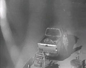 Suspect Standing Near Truck