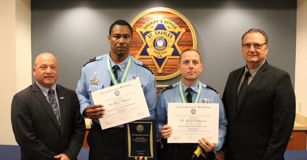 Graduates Lt. Kevin Johnson (left-center) and Lt. Derek Champagne (right-center) are pictured with LPSO Chief Deputy Roy Gros (far left) and Sheriff Craig Webre (far right).